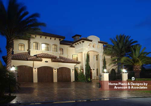 Spanish-influenced home features a beautiful yet bold entrance, six bedrooms, seven and one-half bathrooms, an ultimate combination of tradition and opulent amenities of modern living.
